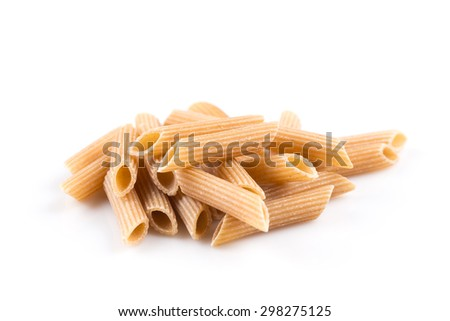 Wholemeal Pasta Penne as close-up shot isolated on white background - stock photo