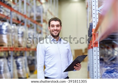 wholesale, logistic, business, export and people concept - happy man or manager with clipboard at warehouse - stock photo