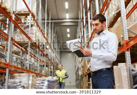 wholesale, logistic, people and export concept - businessman or supervisor with clipboards at warehouse - stock photo