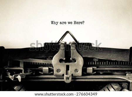 Why are we here? message typed on a vintage typewriter - stock photo