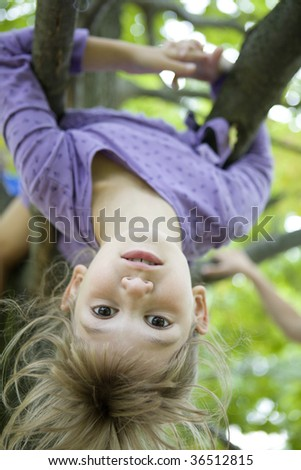 Why go to soccer practice when you can hang from a tree in the backyard? - stock photo