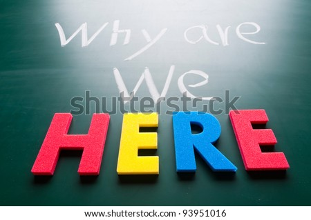 Why we are here, message words on blackboard - stock photo
