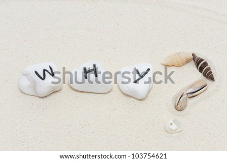 Why word on group of stones with sand background - stock photo