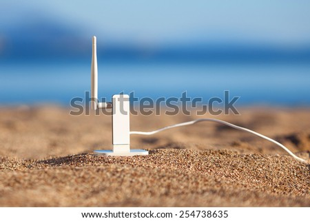 Wi-fi modem on a beach - stock photo