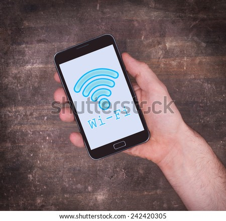 Wi-Fi on a mobile phone, vintage setting - stock photo