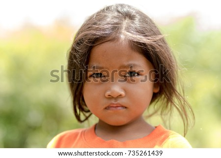 WICHIAN BURI, THAILAND - JULY 28,2017: Portrait of a young Thai girl living in a small Thai Village on a sunny day