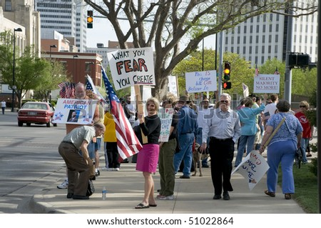 WICHITA, KANSAS - April 15: coffee cup members gather in front of Wichita city hall.  Holding banners and showing support for their cause, April 15, 2010 in Wichita Kansas - stock photo