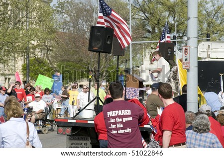 WICHITA, KANSAS - April 15: Tea Party members gather as part of a nation wide rally.  The crowd was holding banners and showing support for their cause, April 15, 2010 in Wichita Kansas