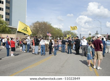 WICHITA, KANSAS - April 15: Tea Party members gather as part of a nation wide rally.  The crowd was holding banners and showing support for their cause, April 15, 2010 in Wichita Kansas - stock photo