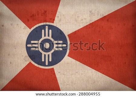 Wichita ,Kansas flag on fabric texture,retro vintage style - stock photo