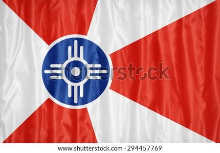 Wichita ,Kansas flag pattern on fabric texture,retro vintage style - stock photo