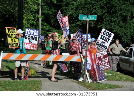 WICHITA, KANSAS - JUNE 6: Abortion Protesters at the funeral of Dr George Tiller on Saturday, June 6, 2009 in Wichita KS. - stock photo