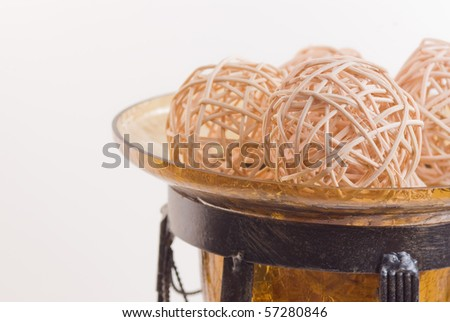 Wicker balls in a glass vase - stock photo