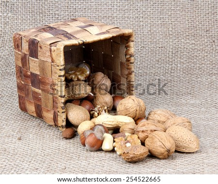 wicker basket and nuts on a old canvas