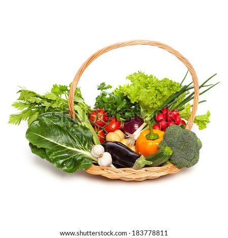 Wicker basket full of vegetables, isolated on white - stock photo