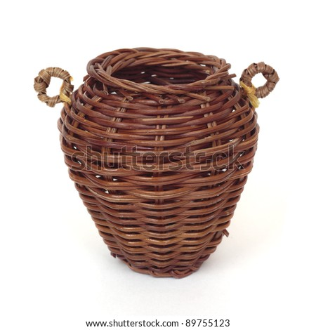 Wicker basket isolated on a white background. - stock photo