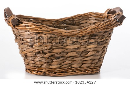wicker basket isolated on white background - stock photo
