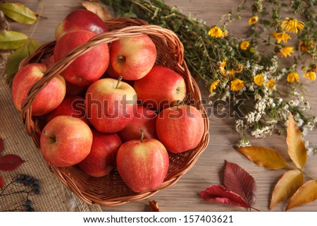 Wicker basket of apples / studio shot of ripe apples in a wicker basket