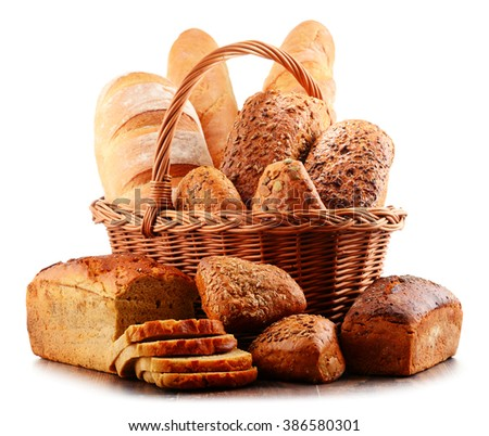 Wicker basket with assorted baking products isolated on white background - stock photo