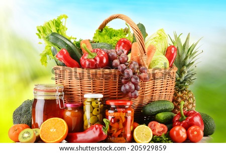 Wicker basket with fresh organic vegetables. Balanced diet - stock photo