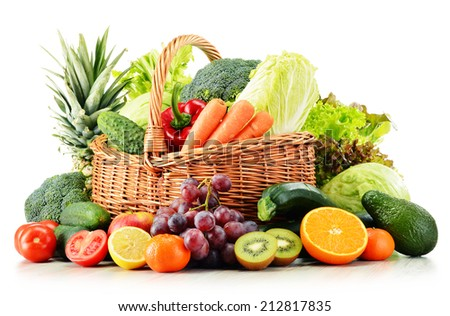 Wicker basket with groceries isolated on white background - stock photo