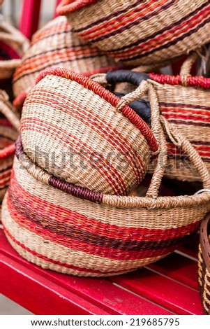 Wicker basket with red stripes on sale at the local farmers market.