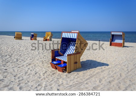 Wicker beach chairs on the beach on the Baltic sea  - stock photo