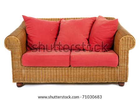 Wicker bench with red pillow isolated at white background - stock photo
