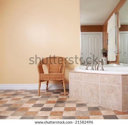 wicker chair in bathroom wiht nice bath and miroir - stock photo