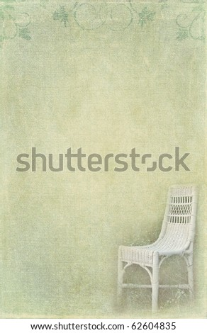 wicker chair in wildflowers on textured background - stock photo