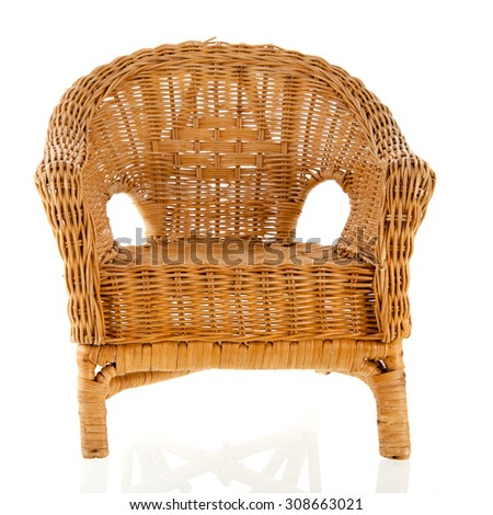 Wicker chair with colorful pillows - stock photo