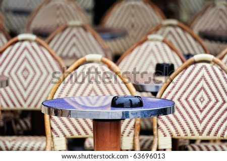 Wicker chairs in the typical cafe in Paris. Photo with tilt-shift effect - stock photo