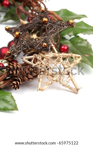 Wicker Christmas star and other Christmas decorations isolated on white. Shallow dof