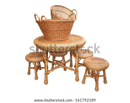 Wicker furniture - table, chair and baskets isolated on white background  - stock photo