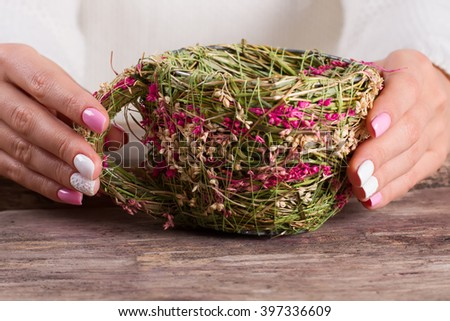 Wicker handmade cup of herbs. Spring manicure with decoration.