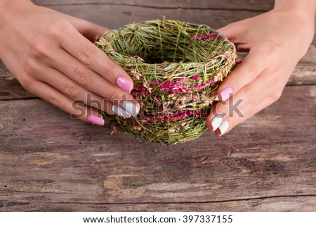 Wicker handmade cup of herbs. Unusual cup with a nice manicure.