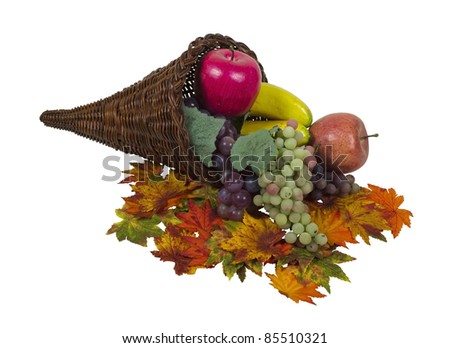 Wicker horn cornucopia which is symbolic for plentiful abundance with colorful fruit and leaves - path included