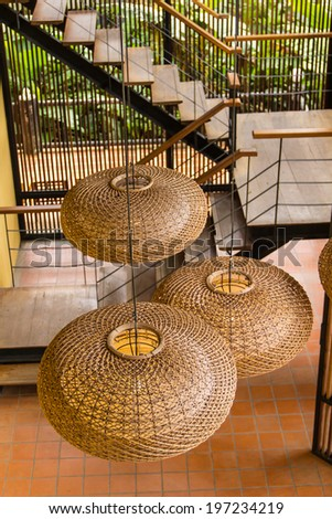 Wicker lamp on ceiling - stock photo