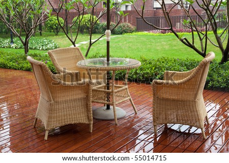 Wicker Patio Chairs And Table Near Garden After Raining Part 79