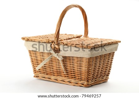 Wicker picnic basket on white background. - stock photo