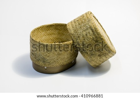 Wicker rice or Kratip or sticky rice basket container that is the bamboo container for holding cooked glutinous rice. - stock photo