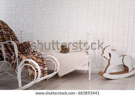 Wicker Rocking Chair With A Warm Blanket In The Nursery