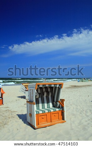 Wicker roofed beach chair standing on the beach
