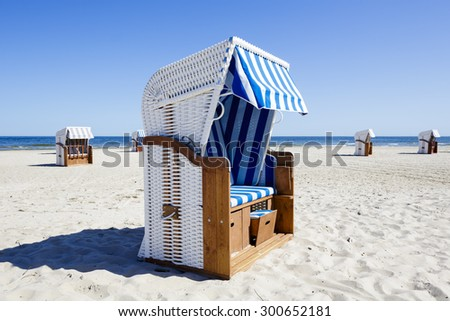 Wicker roofed beach chairs at the seashore in Kolobrzeg in Poland - stock photo