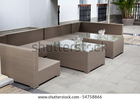 Wicker sofa set in yard - stock photo