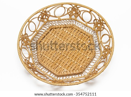 Wicker straw basket in the form of a plate on a white background. - stock photo