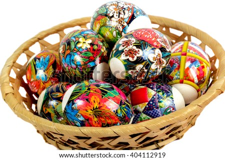 Wicker straw basket with Easter eggs isolated on white background