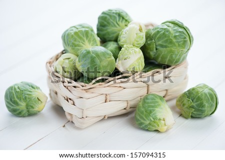 Wicker tray with brussels sprouts, horizontal shot - stock photo