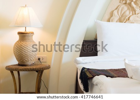 wicker water hyacinth lamp in asian style bedroom. - stock photo