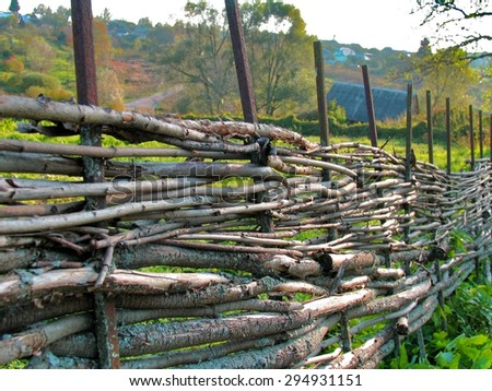 Wicker wood fence from curved wooden twigs